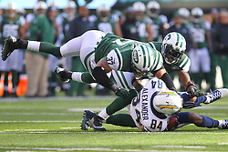 Dec 23, 2012; East Rutherford, NJ, USA; San Diego Chargers wide receiver Danario Alexander (84) is tackled by New York Jets safety Yeremiah Bell (37) during the first half at MetLIfe Stadium.