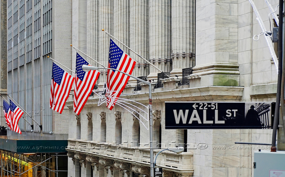 Wall Street sign and American Flags.