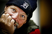"SHOT 10/21/09 7:48:03 PM - Portraits of Rocky Mc aka ""Is-Real"", 57, at the Denver Rescue Mission who was living on the streets for about nine months currently and has been homeless a number of times in his life. He said, ""I never dreamed that I'd have to do what I'm doing right now"". He added that the streets can be a lonely and dangerous place at times. A recent survey by the Metro Denver Homeless Initiative estimates there are more than 11,000 homeless individuals in the seven county metro region and that numbers are up some 20 percent from 2007. (Photo by Marc Piscotty / © 2009)"