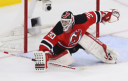 May 25, 2012; Newark, NJ, USA; New Jersey Devils goalie Martin Brodeur (30) makes a save during the second period in game six of the 2012 Eastern Conference finals at the Prudential Center.