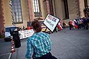 Frankfurt am Main   21 Apr 2015<br /> <br /> Am Dienstag (21.04.2015) hielt die rassistische und islamfeindliche Gruppe PEGIDA (Patriotische Europ&auml;er gegen die Islamisierung des Abendlandes) an der Hauotwache neben der Katharinenkirche in Frankfurt am Main eine Mahnwache unter dem Motto &quot;Wir sind wieder da&quot; ab. Die Kundgebung war wie immer mit Hamburger Gittern abgesperrt und von starken Polizeikr&auml;ften bewacht. Etwa 1000 Menschen nahmen an den Gegenprotesten teil.<br /> Hier: Teilnehmerin der PEGIDA-Kundgebung mit einem kleinen Plakat mit der Aufschrift &quot;PEGIDA Frankfurt&quot;.<br /> <br /> &copy;peter-juelich.com<br /> <br /> [Foto Honorarpflichtig   No Model Release   No Property Release]