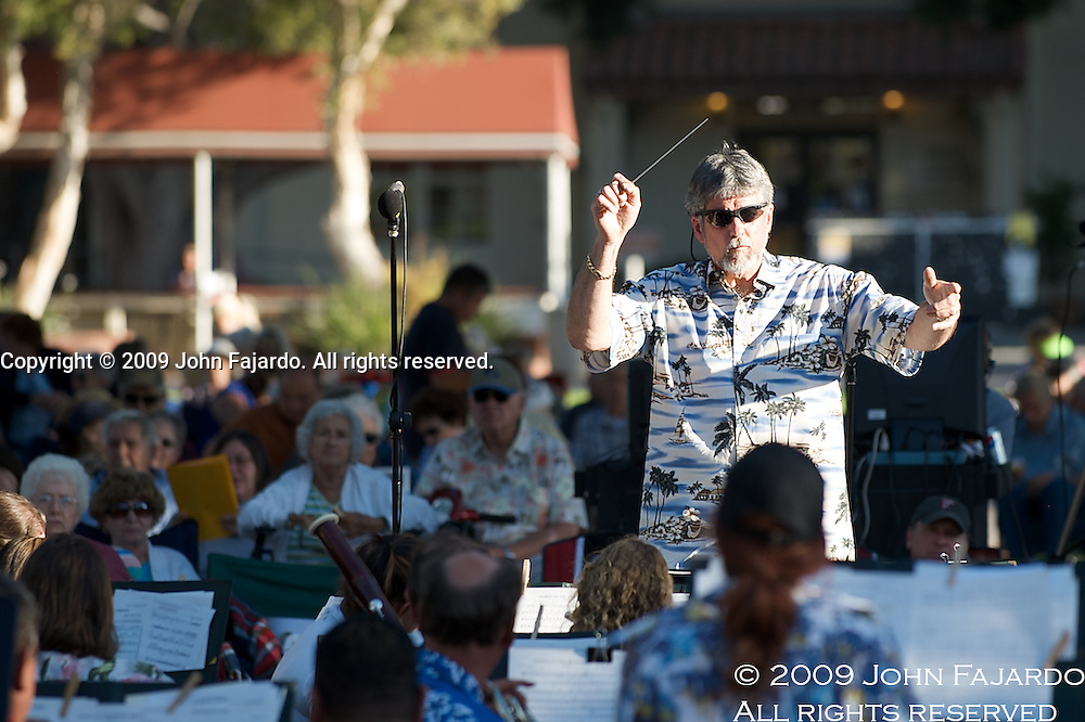 LBCC Dean of Creative Arts and Applied Sciences Dr. Gary Scott conducts the Wind Symphony during the Summer Pops Concert on the lawn of the Liberal Arts Campus of Long Beach City College, Monday July 6, 2009.