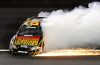 Oct. 16, 2009; Concord, NC, USA; NASCAR Nationwide Series driver Steve Wallace spins during the Dollar General 300 at Lowes Motor Speedway. Mandatory Credit: Jennifer Stewart-US PRESSWIRE