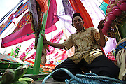 A villager onboard his decorated boat at the Maulid Nabi festival, Cikoang, Sulawesi, Indonesia.