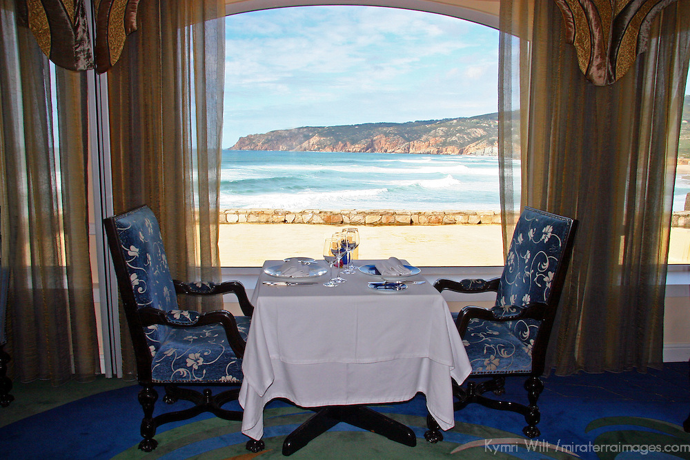 Europe, Portugal, Cascais; A romantic table at Fortaleza do Guincho, a Relais & Chateaux restaurant and hotel on the Estoril coast of Cascais.