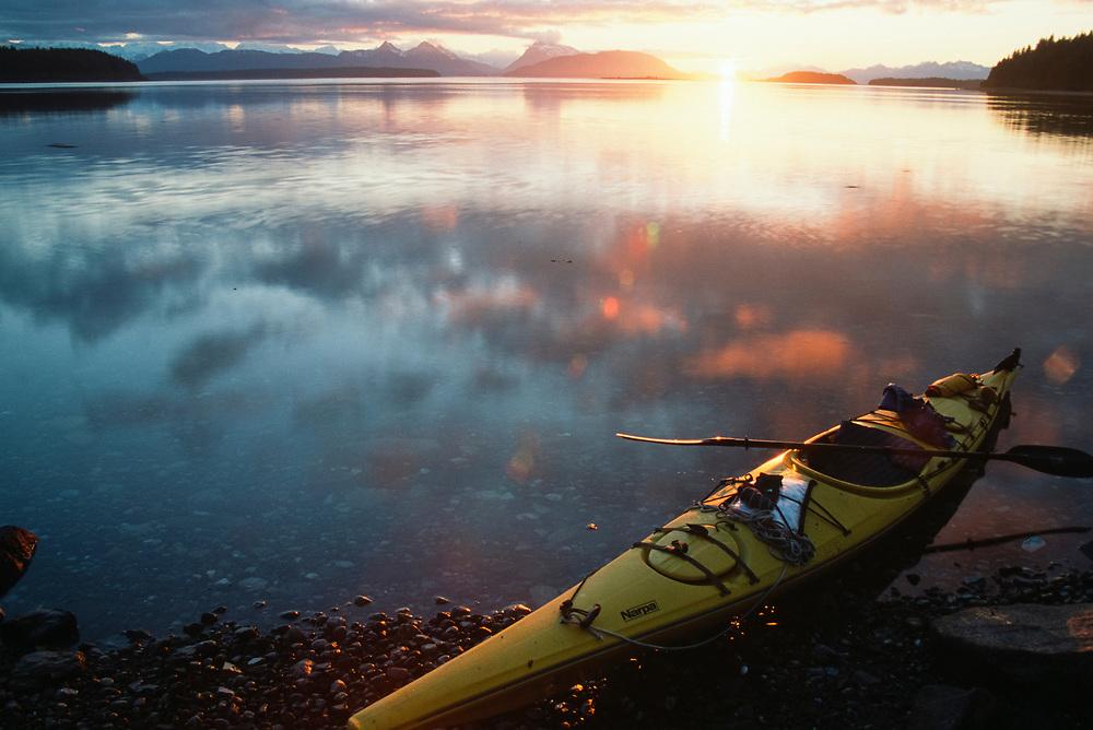 Alaska. Glacier Bay NP.Beardslee Island. A kayak rests on shore at sunset.