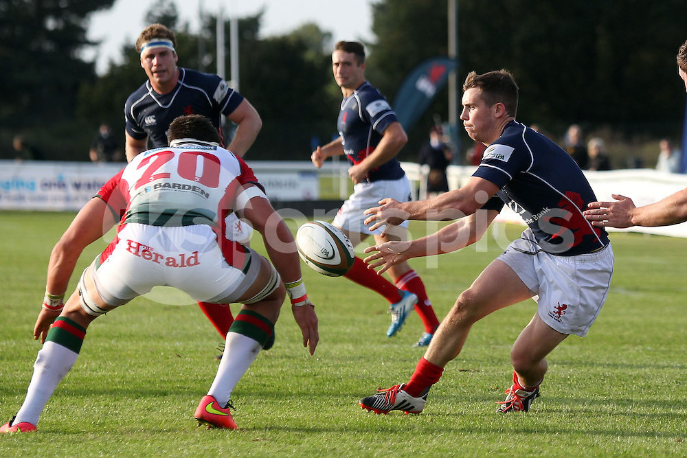 Jamie Stevenson passes to Mark Bright for a try during the Green King IPA Championship match between London Scottish &amp; Plymouth Albion at Richmond, Greater London on Sunday 5th October 2014<br /> <br /> Photo: Ken Sparks | UK Sports Pics Ltd<br /> London Scottish v Plymouth Albion, Green King IPA Championship,5th October 2014<br /> <br /> &copy; UK Sports Pics Ltd. FA Accredited. Football League Licence No:  FL14/15/P5700.Football Conference Licence No: PCONF 051/14 Tel +44(0)7968 045353. email ken@uksportspics.co.uk, 7 Leslie Park Road, East Croydon, Surrey CR0 6TN. Credit UK Sports Pics Ltd