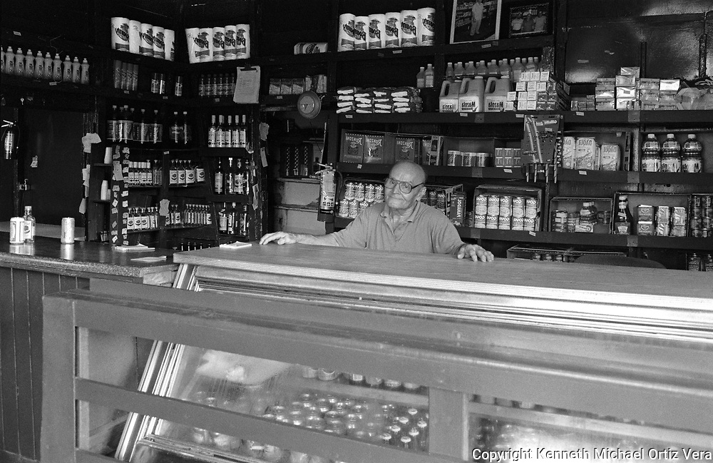 A Store Owner of a local bodega in Aguadilla Puerto Rico.