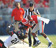 Mississippi wide receiver Ja-Mes Logan (85) is tackled by Southeast Missouri State's Cantrell Andrews (24) at Vaught-Hemingway Stadium in Oxford, Miss. on Saturday, September 7, 2013. (AP Photo/Oxford Eagle, Bruce Newman)