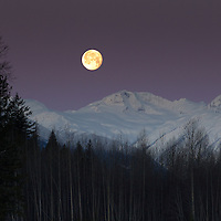 A very early morning moon set as we headed out towards the Hurley Pass to shoot snowboarding, near Pemberton, BC
