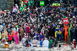 The Loony Dook at South Queensferry, where people dive into the freezing waters of the Firth of Forth on New Year's Day, often in fancy dress..©Michael Schofield.