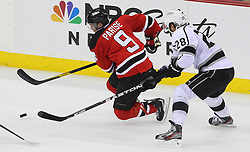 May 30; Newark, NJ, USA; New Jersey Devils left wing Zach Parise (9) skates with the puck while being defended by Los Angeles Kings center Jarret Stoll (28) during the second period of 2012 Stanley Cup Finals Game 1 at the Prudential Center.  The Kings defeated the Devils 2-1.