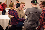 In a lighthearted moment following the day's speakers, Izaak Wendorff lifts up his sister Emma as they chat with friends during the 2017 LCMS Life Conference on Saturday, Jan. 28, 2017, in Arlington, Va. LCMS Communications/Erik M. Lunsford