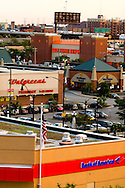 Multiple strip malls are springing up in the south loop neighborhood of Chicago, including such chain stores as Home Depot, Walgreen's, and Bank of America. Also, a now closed Washington Mutual store in in the picture. Washington Mutual, or WaMu, went under in the financial crisis of 2008/09.
