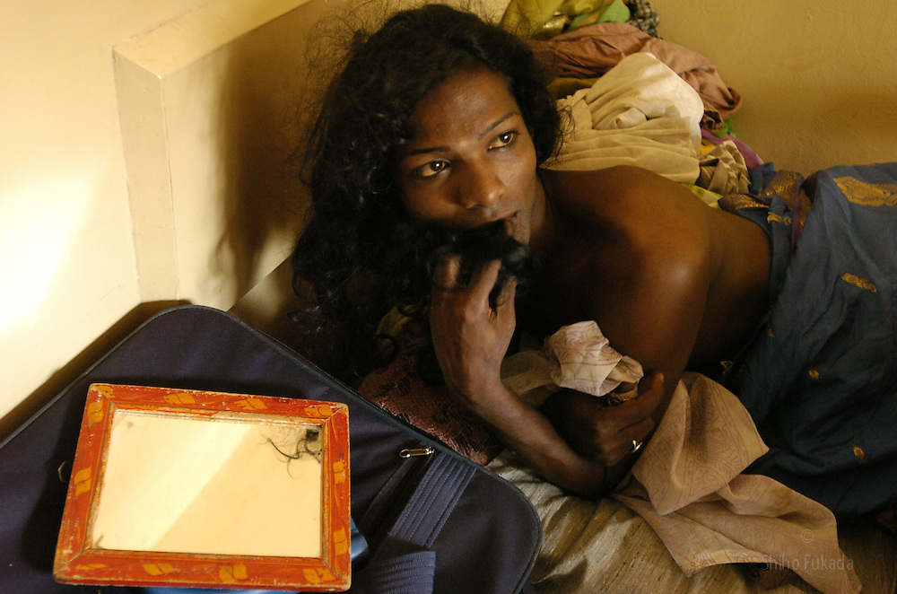 A transgender in bed in Villupuram, India.<br />