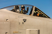 "A Thunderbolt pilot gives the ""hook 'em horns"" gesture while readying for a mission.  Nellis AFB, Las Vegas, Nevada."