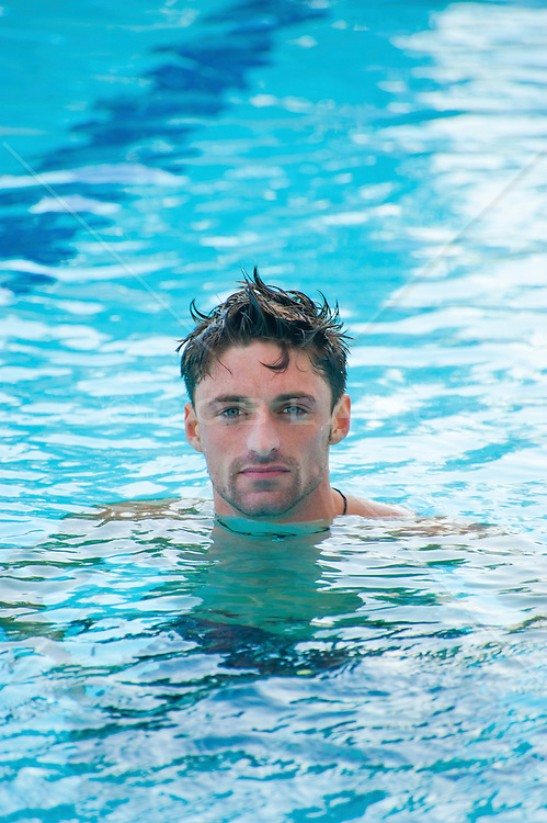 man in a swimming pool rob lang images licensing and