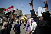 Anti-government protestors cheer as an APC belonging to defected soldiers drives by during a protest march in Yemen's capital, Sanaa on 22 November 2011. Protests take place daily inside anti-government territory. Photo: Lindsay Mackenzie / Falcon Photo Agency.