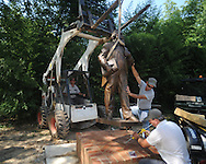 A statue of LQC Lamar by Bill Beckwith is installed at the LQC Lamar house in Oxford, Miss. on Monday, August 2, 2010. Installing the statue are Oxford city employees Greg Pinion, Glen Mooney, Charles Bryan, and Joe Varner.