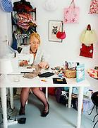 Owner and designer at hand bag shop, Mitte, East Berlin.