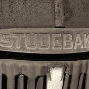 Rusted Vintage Studebaker Truck Emblem - Motor Transport Museum - Campo, CA - Sepia Black & White