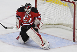 Mar 27; Newark, NJ, USA; New Jersey Devils goalie Martin Brodeur (30) makes a glove save during the third period of their game against the Chicago Blackhawks at the Prudential Center. The Devils defeated the Blackhawks 2-1 in an overtime shootout.