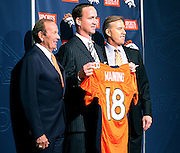SHOT 3/20/12 1:25:41 PM - The Denver Broncos' owner Pat Bowlen, left, and John Elway, right, introduced free agent quarterback Peyton Manning, center, at team headquarters in Englewood, Co. at a press conference on Tuesday Marc 20, 2012. Manning is coming off neck surgery and was released by the Indianapolis Colts. He signed a five year, $96 million contract with the Broncos..(Photo by Marc Piscotty / © 2012)