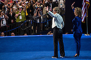 Former Rep. Gabrielle Giffords (D-AZ) and Rep. Debbie Wasserman Schultz (D-FL) appear on stage at the Democratic National Convention on Thursday, September 6, 2012 in Charlotte, NC.