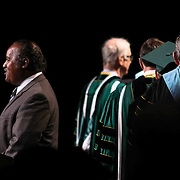 "Lieutenant Kevin Pierce, LEFT, sings ""God Bless the U.S.A"" by Lee Greenwood during Wilmington University commencement exercise Sunday, May 17, 2015, at Chase Center On The Riverfront in Wilmington Delaware."