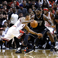 29 January 2012: Miami Heat small forward LeBron James (6) defends on Chicago Bulls point guard Derrick Rose (1) during the Miami Heat 97-93 victory over the Chicago Bulls at the AmericanAirlines Arena, Miami, Florida, USA.