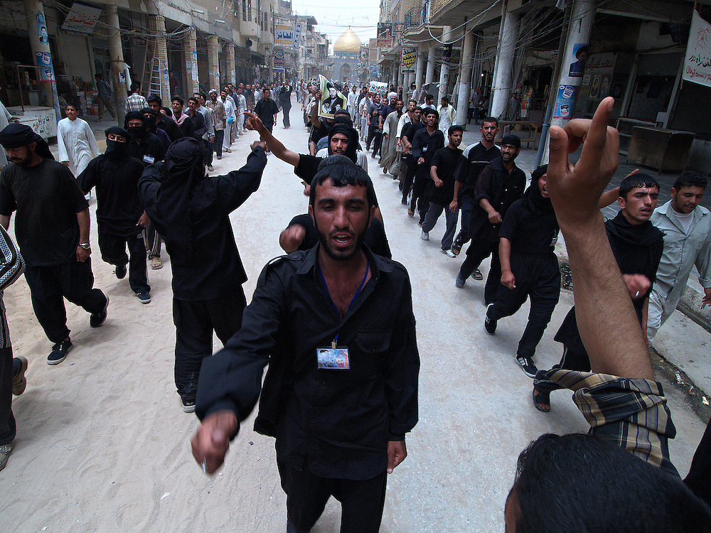 Members of Moqtada al-Sadr's Mehdi Army march during a ceremony in which they claimed to have disbanded and handed in their weapons in Najaf, Iraq on the 27th May 2004. This claim subsequently proved to be false and the militia continues to fight against US occupying forces.