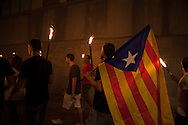 Catalan people with the Estelada, the independence flag. Torchlight march on the eve of National Day (Diada). Every year the people of Catalonia celebrates the Independence Day on 11th September, when Catalonia troops where defeated by the army of Spain at the Siege of Barcelona in 1714. 300 hundreds years later, in 2013, Catalonian people commemorates this date protesting peacefully and claiming the independence with a human chain, called the Via Catalana, of around 400.000 persons, spreaded 400km along the whole catalonian land.