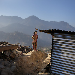 Sumitra, 10, stands outside the temporary village home their parents put up since the earthquake. <br /> <br /> Niruta and Durga were married 9 years ago, when they were just 14 and 16 years old in the Kagati village of Nepal. The 2015 earthquakes devastated Nepal and left girls and women in an increasingly vulnerable position, leading experts to believe child marriage rates will increase over the coming years.