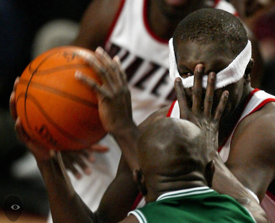 The Blazers'  Zach Randolph (50) gets a hand to the face from the Celtics' Tony Delk (7) who accidentally pulled his swaetband down over his eyes. The Celtics beat the Blazers 100-92.