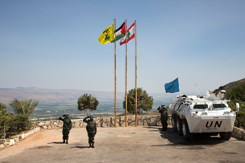UN peacekeepers on the Blue Line, the border demarcation between Lebanon and Israel, in south Lebanon. The flags of Hezbollah, Palestine and Lebanon fly in the background. Israel occupied southern Lebanon from 1978 until 2000, and the area remains highly sensitive. A cross border attack by Hezbollah in 2006 caused a 34-day long war between Israel and Hezbollah.
