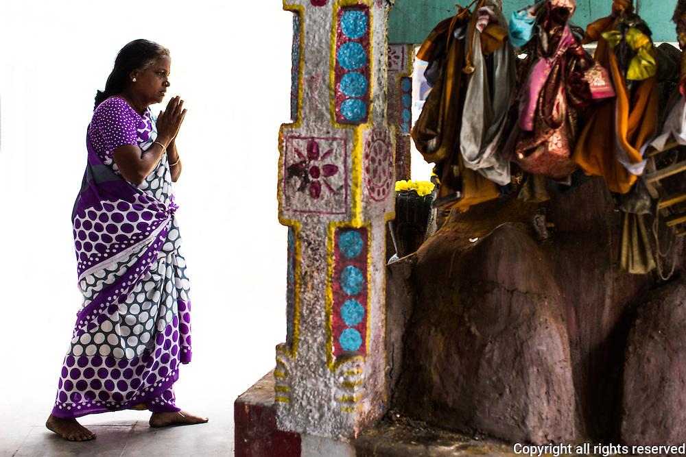 Worshipper at a temple outside Karaikudi, Tamil Nadu, India