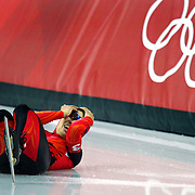 Japanese Women's Team Pursuit Speed Skating team member Hiromi Otsu (#3) holds her head and starts to cry after crashing into the wall headfirst in the B Finals at the Oval Lingotto in Turin, Italy on Thursday February 16, 2006. The crash cost the Japanese team a shot at a bronze medal as they were eliminated after the Russian team lapped her after the fall. The U.S. men finished 6th in the event and the U.S. women finished 5th..(Photo by Marc Piscotty / © 2006)