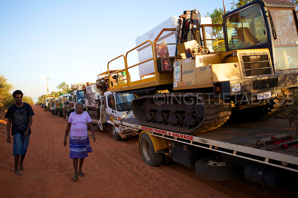 A large convoy of earth moving equipment at a stand still during a protest, where protesters chained themselves in the middle of Manari  Rd. Broome, WA