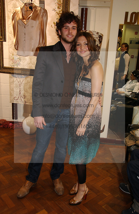 GUY &amp; JO BERRYMAN, he is rock group Coldplays Bassist  at a party to celebrate the opening of the new fashion store Jezebell at 59 Blandford Street, London W1 on 20th April 2006.<br />