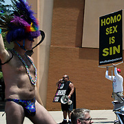 Ruben Israel, middle, and a protester who chose not to give his name from Official Street Preachers make their message is heard during the Columbus Gay Pride Parade on June 24, 2006.