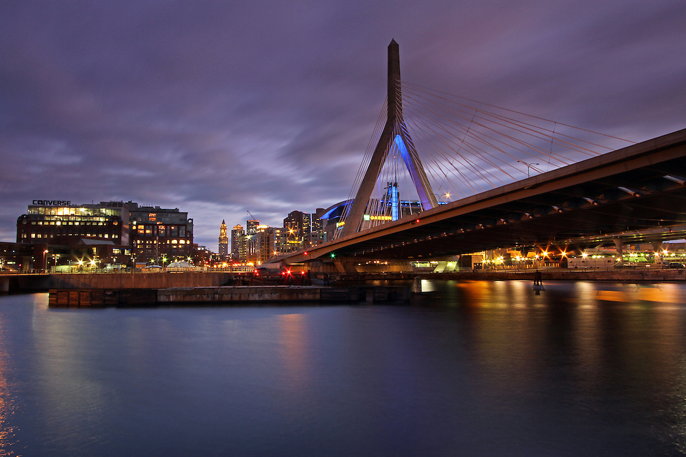 Skyline photography images of the Converse headquarter in Boston are available as museum quality photography prints, canvas prints, acrylic prints or metal prints. Prints may be framed and matted to the individual liking and decorating needs:<br /> <br /> http://juergen-roth.artistwebsites.com/featured/converse-juergen-roth.html<br /> <br /> Converse headquarter in downtown Boston. The company moved recently from North Andover to Beantown and plans on growing with the City.<br /> <br /> The TD Garden,  previously also known as the Shawmut Center,  the FleetCenter or the TD Banknorth Garden is a multi purpose arena in Boston,  Massachusetts. Its nickname is the Boston Garden or The Garden). TD Garden is home to the NHL team of Boston Bruins and NBA Boston Celtics. It is also citywide known for the site of the annual Beanpot college hockey tournament. <br /> <br /> The Leonard P. Zakim Bunker Hill Memorial Bridge is a cable-stayed bridge across the Charles River in Boston,  Massachusetts. This photography image shows the Zakim Bridge,  Spaulding Rehabilitation Hospital,  TD Bank North Garden,  North Station,  and their reflections at twilight as seen from the Paul Revere Park in Boston. Leonard Zakim was a civil rights leader. The Zakim bridge  was built as part of the Boston's Big Dig and it represents the worlds widest cable-stayed bridge.<br /> <br /> Good light and happy photo making! <br /> <br /> My best,  <br /> <br /> Juergen<br /> Fine Art Prints: www.RothGalleries.com<br /> Photo Blog: http://whereintheworldisjuergen.blogspot.com<br /> Twitter: @NatureFineArt<br /> Facebook: https://www.facebook.com/naturefineart
