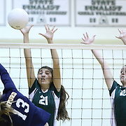 Archmere Nicole Kelly (12) block the spike attempt during the 2nd Round of the 2015 DIAA Girls Volleyball Tournament Saturday, Nov. 07, 2015 at Archmere Academy in Claymont.