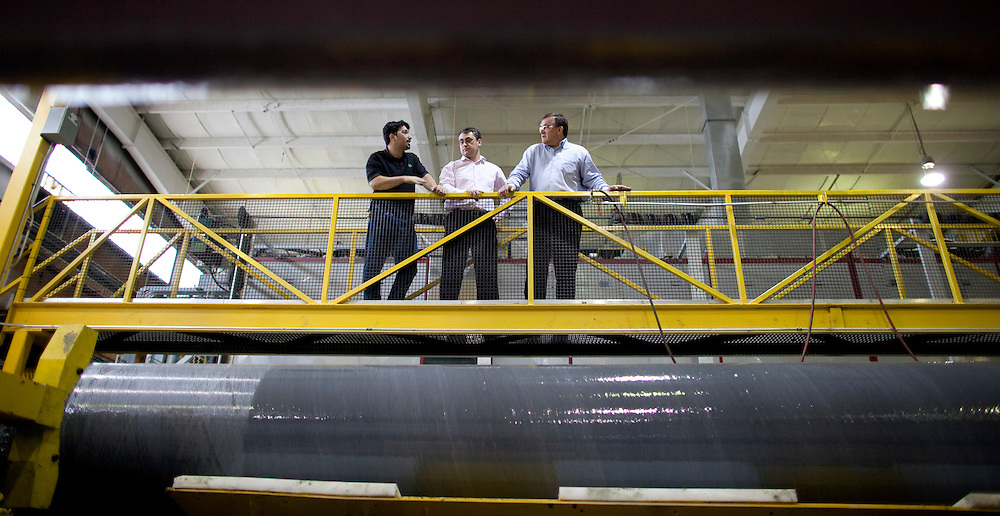 Tilbury, Ontario ---10-01-06--- Paul Giannelia, right, CEO of RS Technologies talks with colleagues at the company's manufacturing plant in Tilbury, Ontario where they are producing their composite utility poles. <br /> GEOFF ROBINS The Globe and Mail