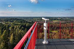 Tehvandi viewing platform in Estonia. Binoculars, railing, forest.