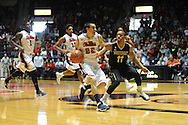 Mississippi's Marshall Henderson (22) vs. Vanderbilt guard Kyle Fuller (11) in Oxford, Miss. on Saturday, March 8, 2014. (AP Photo/Oxford Eagle, Bruce Newman)