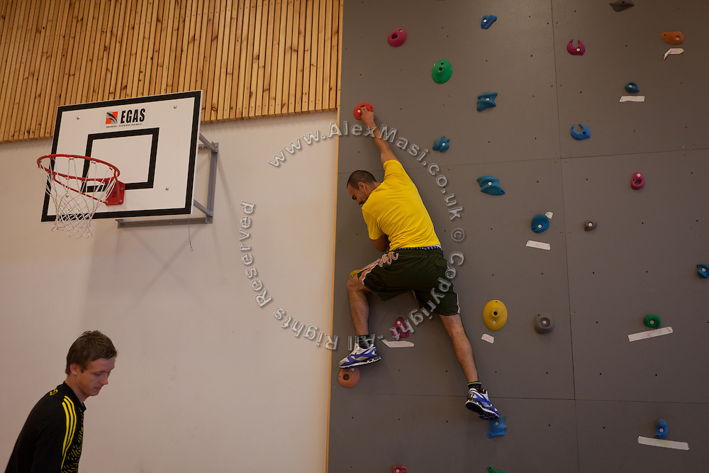 An inmate is taking part to a climbing session during the time regularly spent carrying out physical exercise and learning about the human body inside the luxurious Halden Fengsel, (prison) near Oslo, Norway.