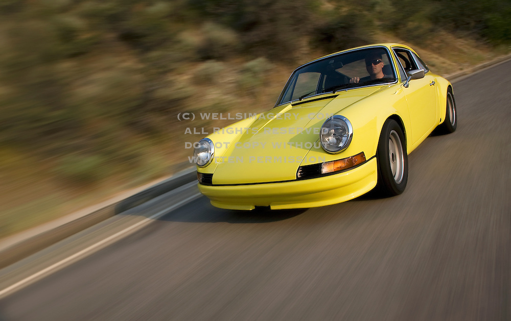 Image of a blurred motion sports car in Boise, Idaho, Pacific Northwest,1972 Porsche 911 T RS, model and property released