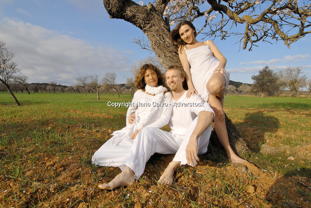 MR Three friends, a spanish woman, a brazilian woman and a sweedish man, enjoying themselves in the fields of Ibiza, Spain