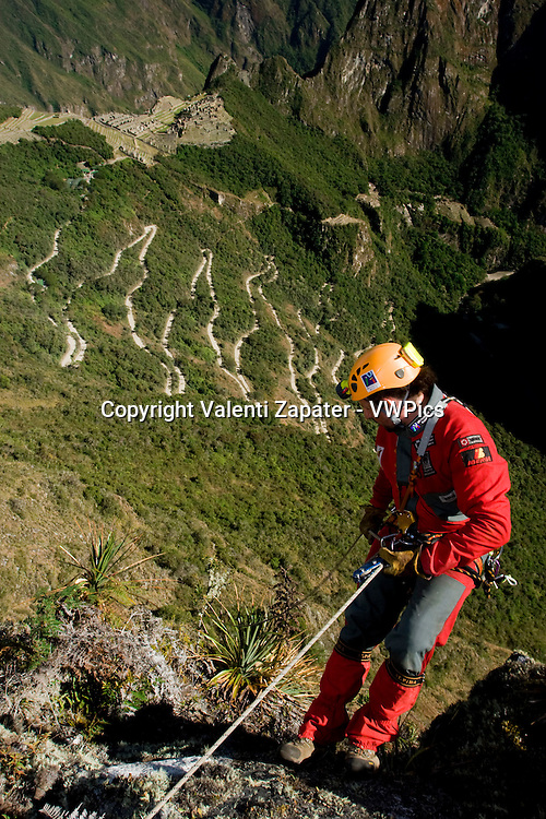 Ukhupacha team rapelling and exploring near Machupicchu. Cusco, Peru