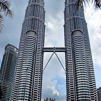 Petronas Twin Towers in Kuala Lumpur, Malaysia<br /> Looking up at the 88 floors of the Petronas Twin Towers in Kuala Lumpur, Malaysia, is awesome and humbling.  Each tower was the world's tallest from 1998-2004 and they are still the biggest twins at 1,483 feet with the deepest foundations at 374 feet.  The price tag was equally impressive: $1.6 billion.